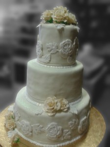 Three Tier White Rose Wedding Cake