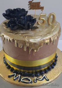 Black and gold tall cake